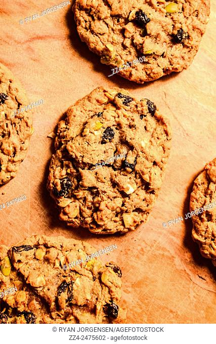 Decandent food still life photo of homemade cookies made with raisins, rolled oats, coconut, macadamias, pepitas with a hint of cinnamon