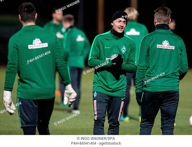 New team member Thomas Delaney (c) and Justin Eilers of the Bundesliga soccer club Werder Bremen talk during the first training session for the second half of...