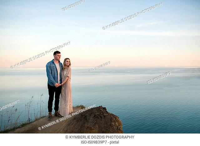 Couple enjoying view on cliff, Ottawa, Ontario