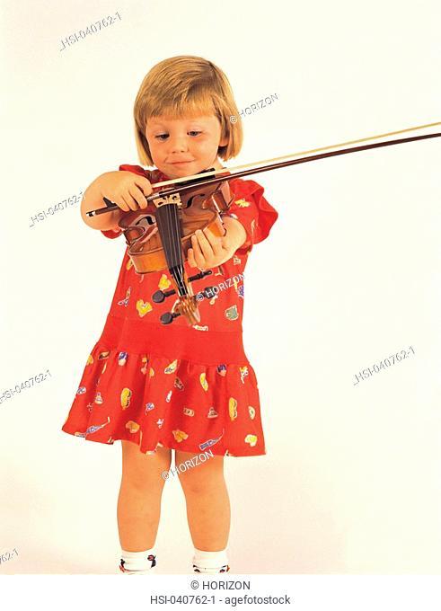 Studio shot of girl playing with violin