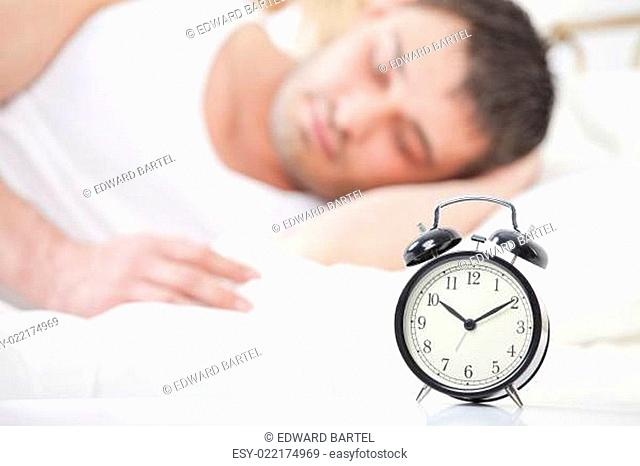 Man sleeping with alarm clock