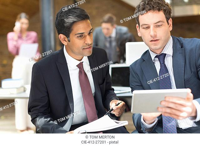 Businessmen working with digital tablet in office
