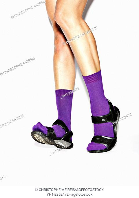 Legs with purple socks