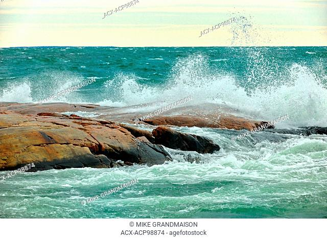 Waves in Georgian Bay crashing on rocks Killarney Provincial Park Ontario Canada
