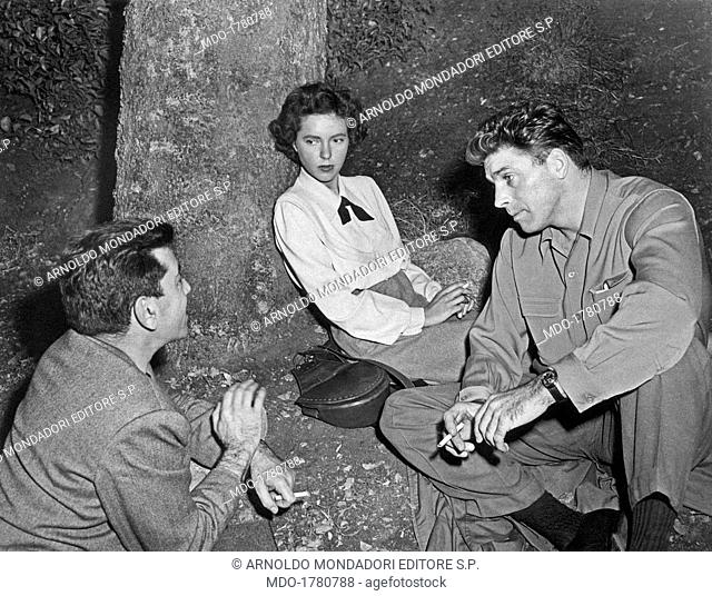 Louisa Horton Hill, Irving Reis and Burt Lancaster on the set of All My Sons. American actress Louisa Horton Hill leaning against the trunk of a tree American...