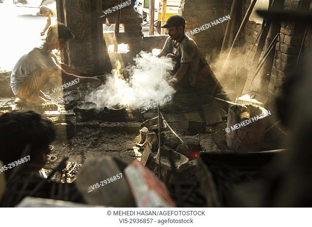 Bangladeshi laborer works at molding factory near old Dhaka. Workers and labor activists have complained that many Bangladeshi factories pay wages that are...
