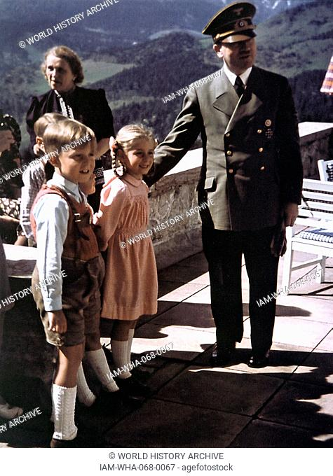 Colour photograph of Adolf Hitler (1889-1945) Austrian-born German politician and leader of the Nazi Party, with children. Dated 1940