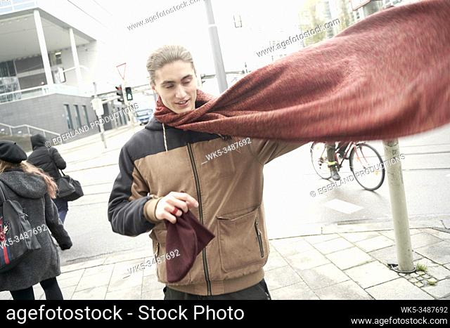 young man with winter scarf
