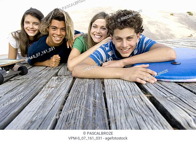 Portrait of two teenage couples smiling