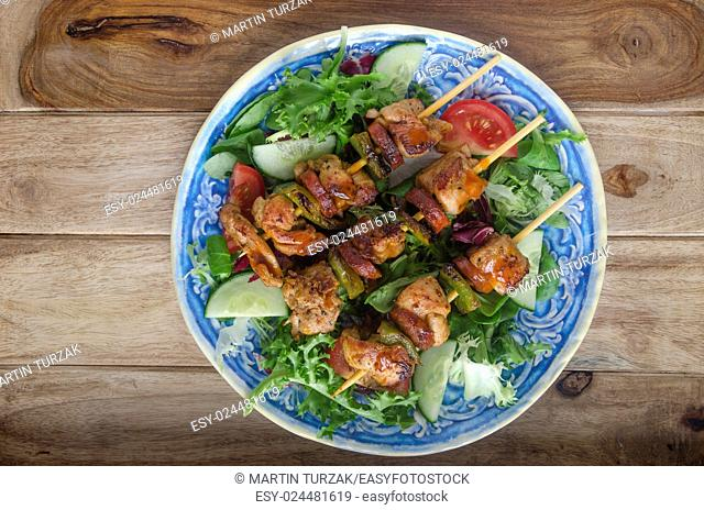 Chicken and chorizo skewers with salad