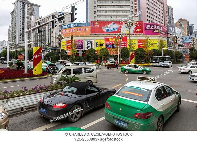 Kaili, Guizhou, China. Street Traffic at a Busy Intersection