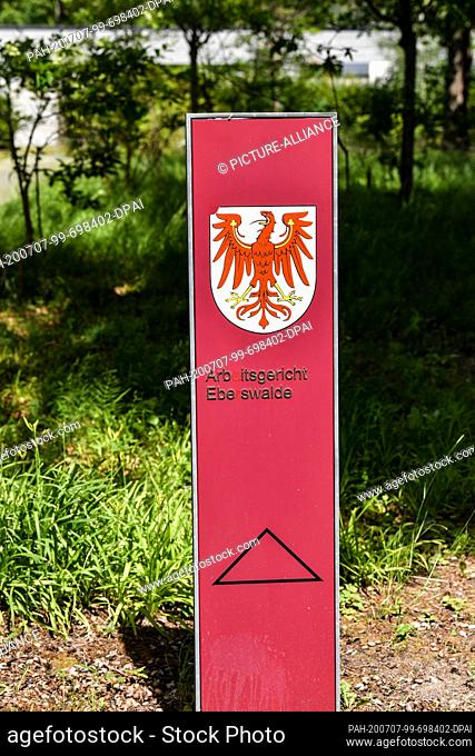 06 July 2020, Brandenburg, Eberswalde: A signpost to the Eberswalde labor court on the premises of the state authority center