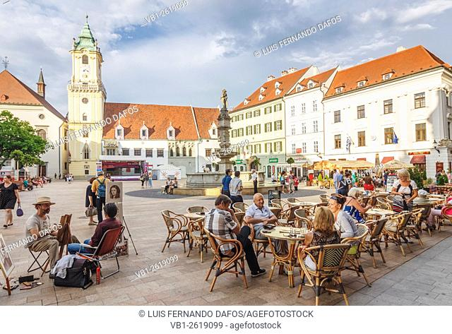 Old Town main square with people at a street cafe. Bratislava, Slovakia