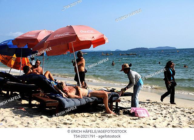 Foot massage on beach