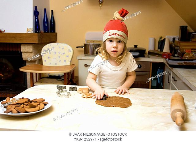 Two Years Old Girl Cooking Gingerbread