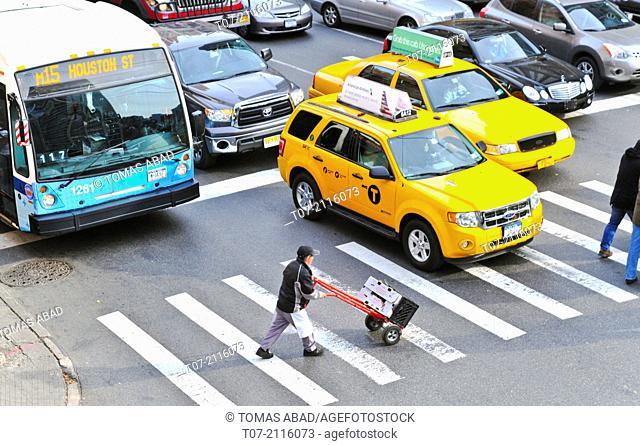 MTA M15 Public Transportation bus via 60th Street and 2nd Avenue, Midtown Manhattan, New York City, USA. Car and pedestrian traffic approaching the Ed Koch...