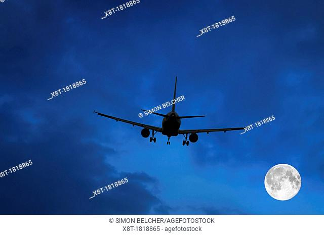 Airplane and Moon in Blue Sky
