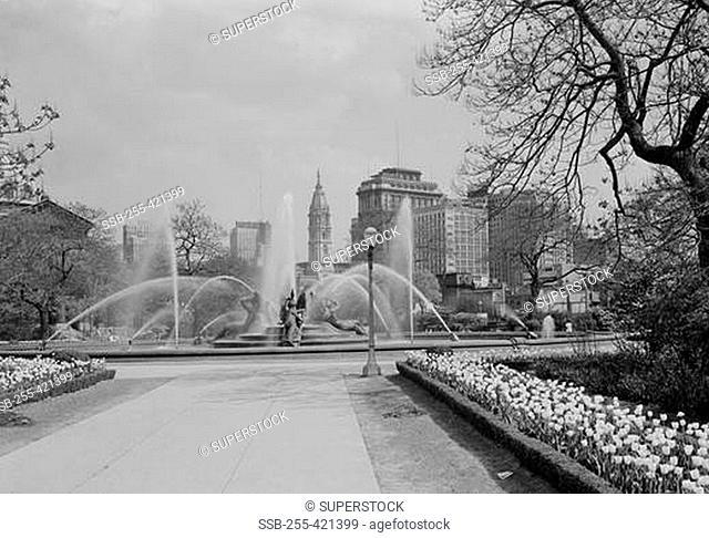 USA, Pennsylvania, Philadelphia, Fountains at Logan Circle with midtown skyline in background