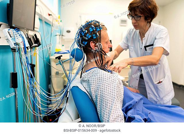 Reportage in the epileptology unit in Nice Hospital, France. Epilepsy diagnosis: EEG in a 52-year old patient hospitalized in the neurology service following a...