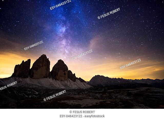 The night sky peppered with thousands of stars over Drei Zinnen ( Tre Cime di Lavaredo) Dolomites, Italy