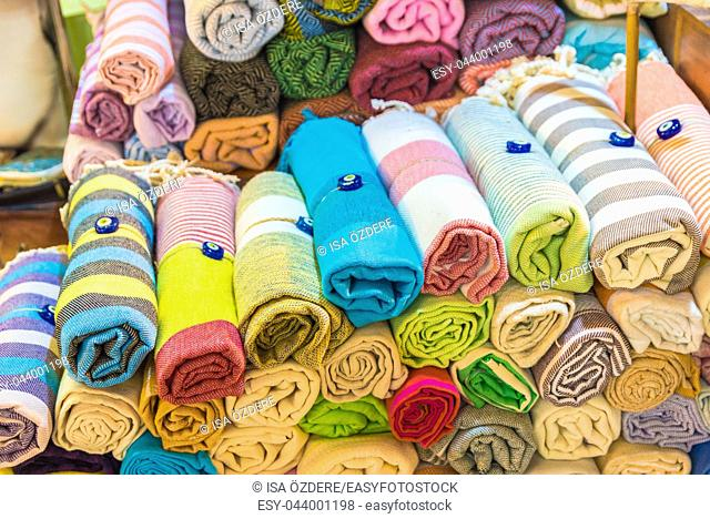Composed Roll shaped stacked Traditional colorful silk , cashmere head scarves or shawls and fabrics for sale in Grand Bazaar, Istanbul, Turkey