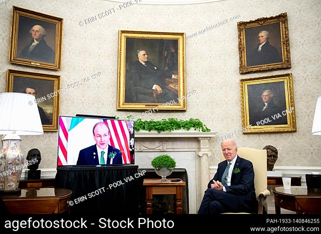 U.S. President Joe Biden participates in a virtual bilateral meeting with Ireland's Prime Minister Micheál Martin in the Oval Office at the White House in...
