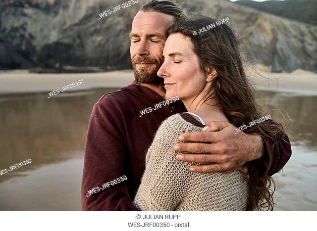 Portugal, Algarve, affectionate couple on the beach