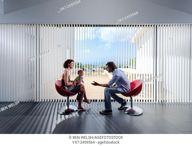 Couple with a baby in a modern house