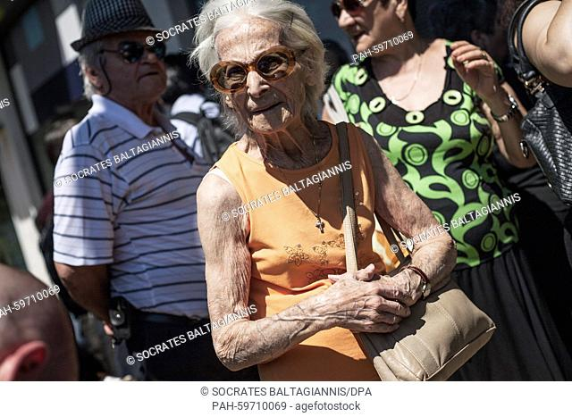 An elderly woman waits outside a bank to get her pension in Athens, Greece, on the 1st of July 2015. Greece's government has made new concessions in talks with...
