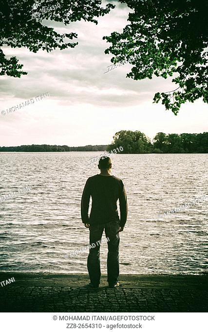 Man standing by the lake