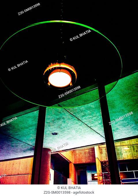 A round ceiling light fixture inside a pub in a contemporary building, Ontario, Canada