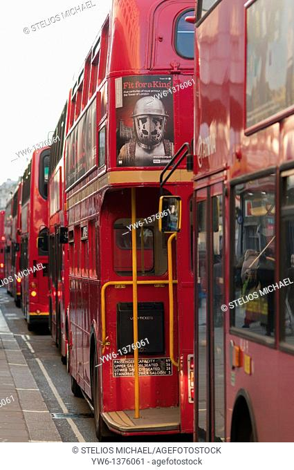 London buses queuing in a bus lane to get into Trafalgar Square in London,England