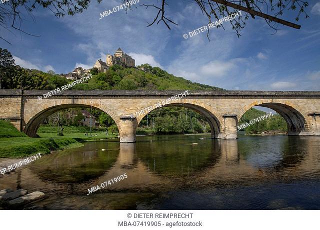 Old bridge in front of castle rock, Grolejac, Dordogne, France
