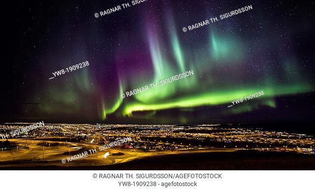 Aurora Borealis or Northern lights over Reykjavik and suburbs, Iceland