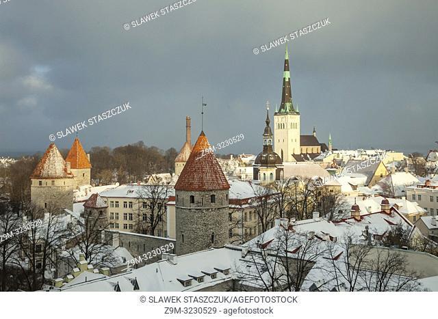 Winter day in Tallinn old town, Estonia. St Olaf's church dominates the city skyline