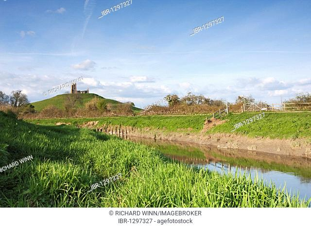 View of Burrow Mump in the early evening, with the River Parrett in the foreground, Somerset, England, United Kingdom, Europe