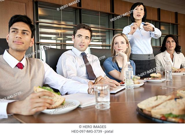 office coworkers at luncheon meeting