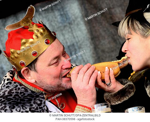 Thuringia's 'Fried Sausage King' RudiButkus from Suhl and Thuringia's 'Sausage Queen' Miriam Wagner from Triebes share a Thuringian fried sausage in Erfurt