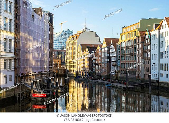 Old houses along the Nikolaifleet canal in early morning, Altstadt, Hamburg, Germany