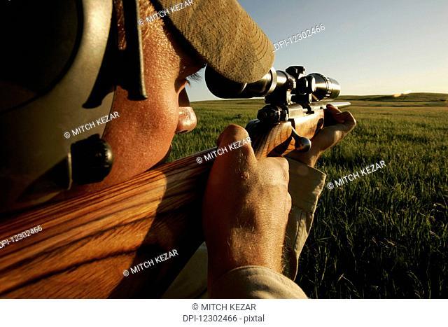 Hunter Aims While Prairie Dog Hunting