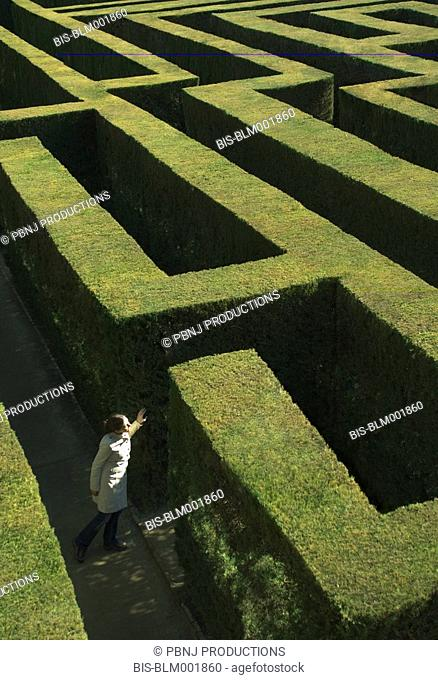 High angle view of woman in labyrinth