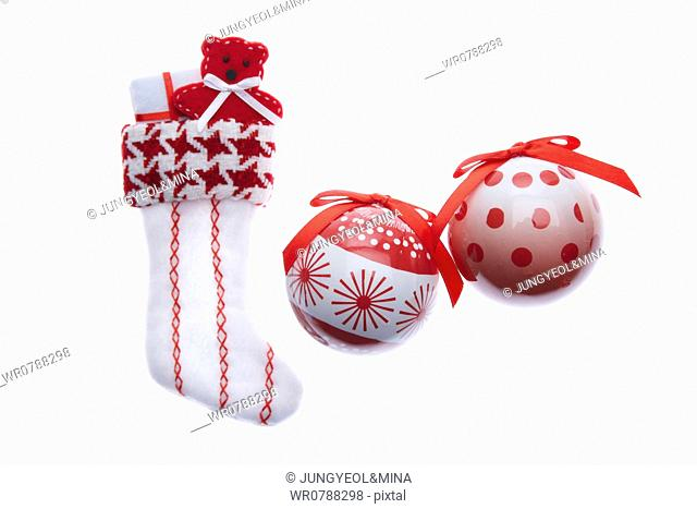The Christmas stocking with red and white Christmas ball decorations