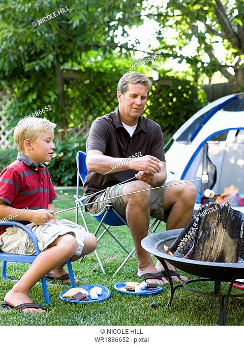 father and son camping in the backyard