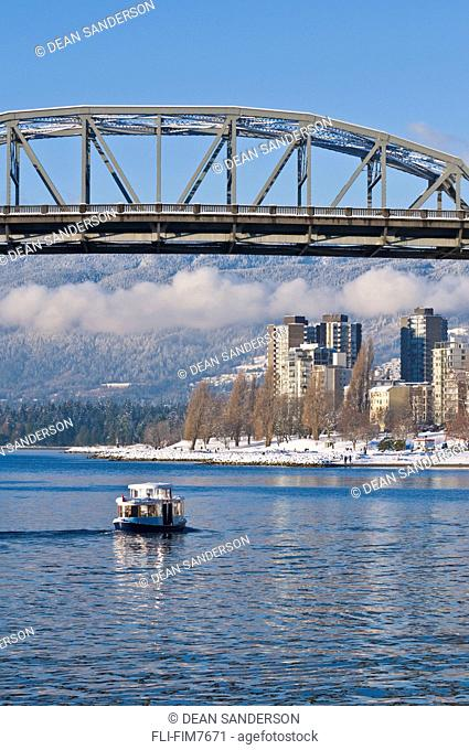 Harbour taxi going under Burrard street bridge after snowfall, Vancouver, British Columbia