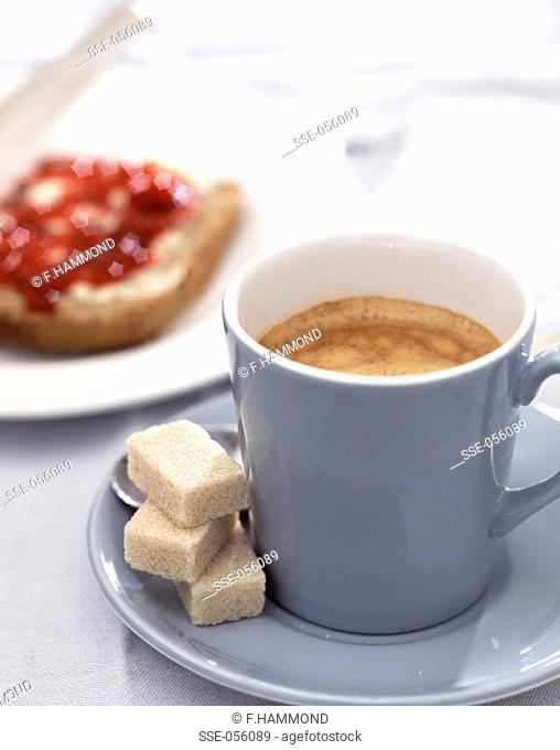 Coffee, sugar cubes, bread and jam