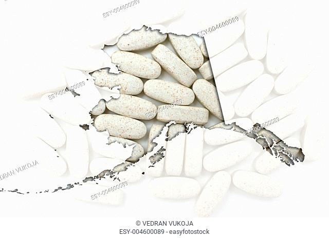 Outline Alaska map of with transparent pills in the background