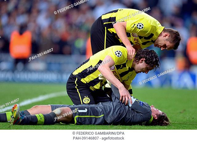 Dortmund's Neven Subotic (C) with goalkeeper Roman Weidenfeller and Sebastian Kehl (top) during the UEFA Champions League semi final second leg soccer match...