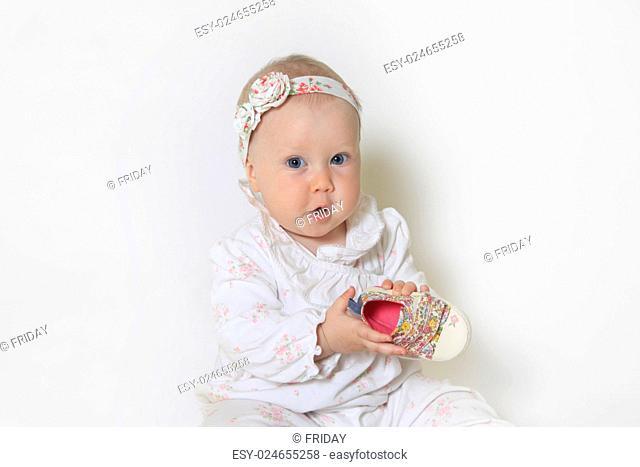 Beautiful small kid girl in studio