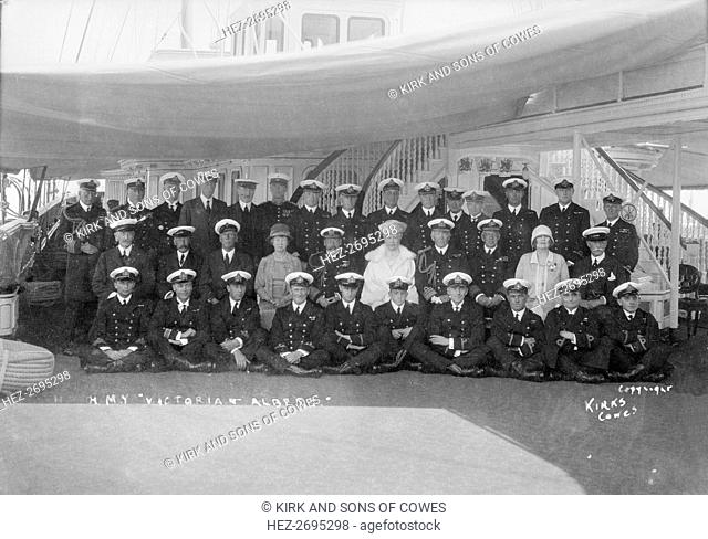 King George V and Queen Mary aboard 'HMY Victoria and Albert', with her crew, c1933. Creator: Kirk & Sons of Cowes