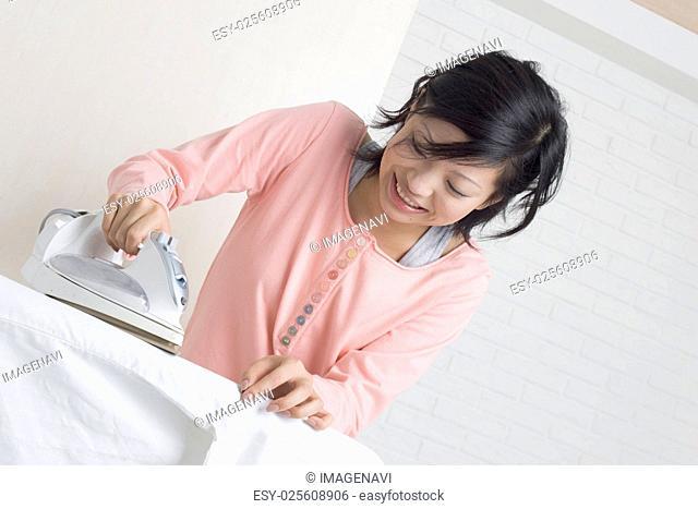 Woman ironing cloths